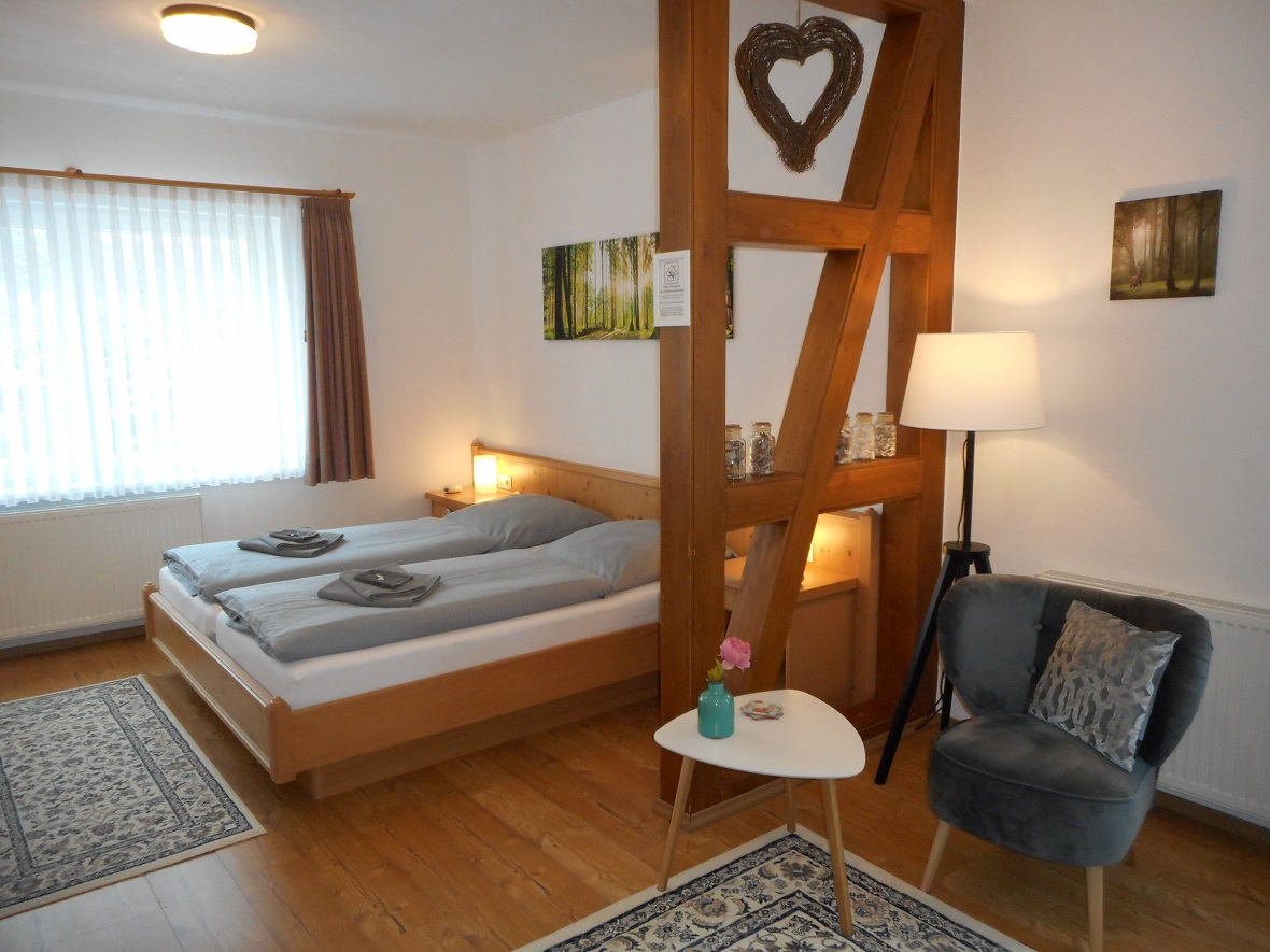 Large double bedroom with sitting area and balcony